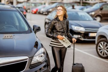 Woman renting a car